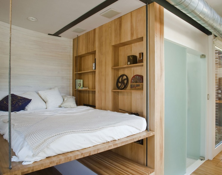 Retractable bed rises up to the ceiling small houses - Beds hanging from ceiling ...