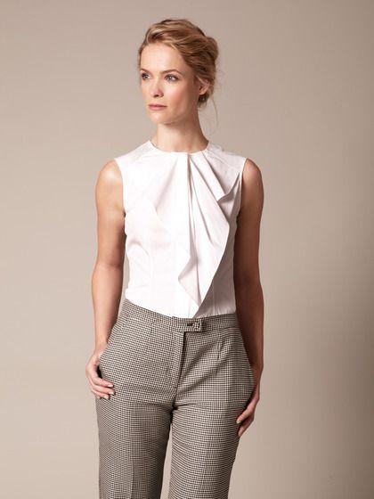 Carolina Herrera Cotton Handkerchief Ruffle Blouse. (Lovely with checked trousers or a bright mini.)