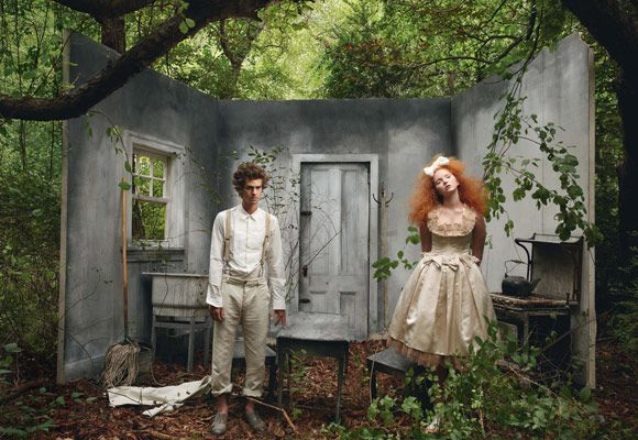Annie Leibovitz.    Such an awesome idea for a shoot...just find three thick pieces of (there are a few things you could use), get some paint, make a few cut outs for windows, doors, and grab some props.     I think it's awesome. She's a big inspiration to me.