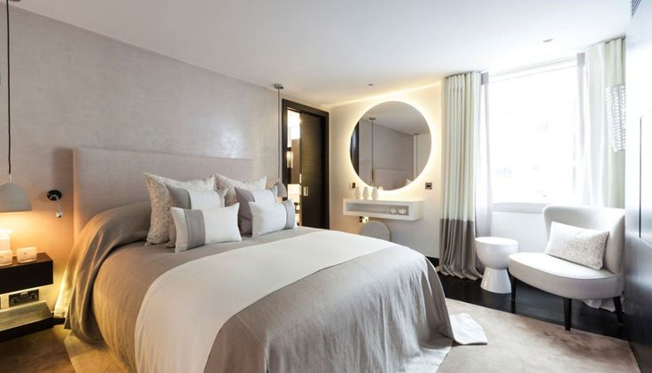 Stylish London Apartment for rent - Henrietta Street (6) Lots of luxury packed in this smaller bedroom space.  That backlit mirror is really cool and I like the use of the pocket door to save much needed floor space.