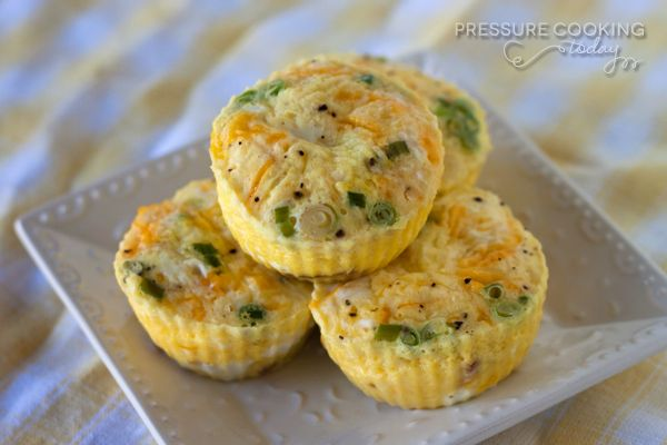 """Egg muffins """"bake"""" up light and fluffy in the pressure cooker. Sort of like a quiche without the crust."""