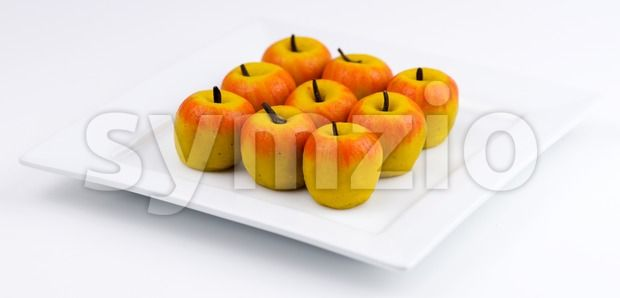 Stock photo of Traditional Indian apple shaped barfi from $1.99. Mini apple shaped Indian barfi sweets made out of almond...