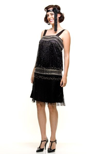 This is such a fun and current version of a flapper dress! Shown in a black satin with beaded straps and a thick beaded dropped waistband. Dripping with beaded fringe throughout. A great overall cocktail dress or flapper dress for a theme party/wedding. Shown on model Sunny Subramanian. Make up by RockMyMakeUp.