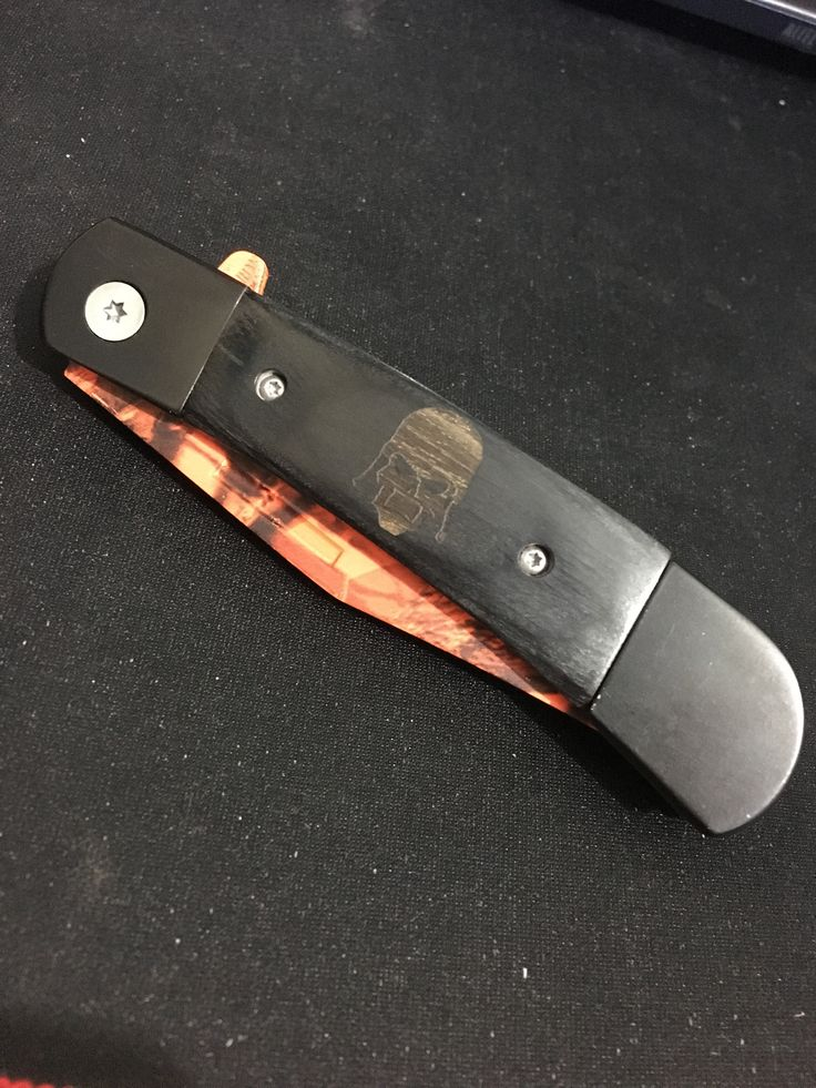 It's a skull head wooden handle knife it also has orange and black splatter paint covering the actual blade. the blade sharpened as well. This is a brand-new clean knife, edc  | Shop this product here: http://spreesy.com/Lazewerkz/7 | Shop all of our products at http://spreesy.com/Lazewerkz    | Pinterest selling powered by Spreesy.com
