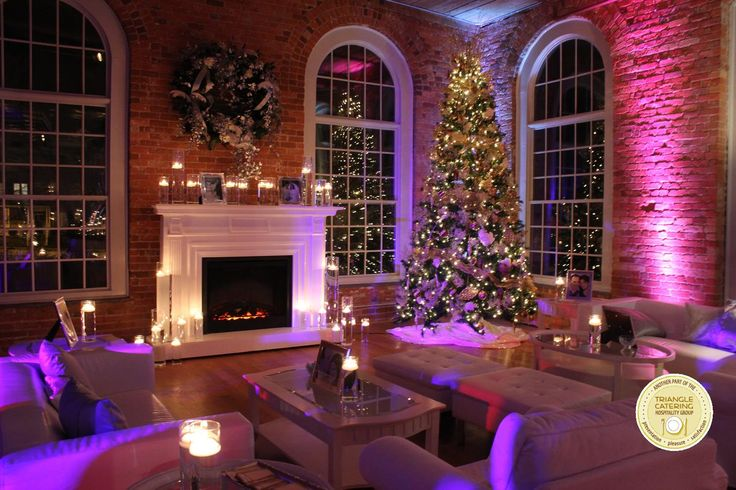 Lounge area for winter wedding with Christmas tree and white fire place at The Cotton Room in Durham, NC