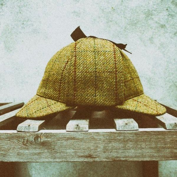 Green tweed cap. The one worn by Sherlock.