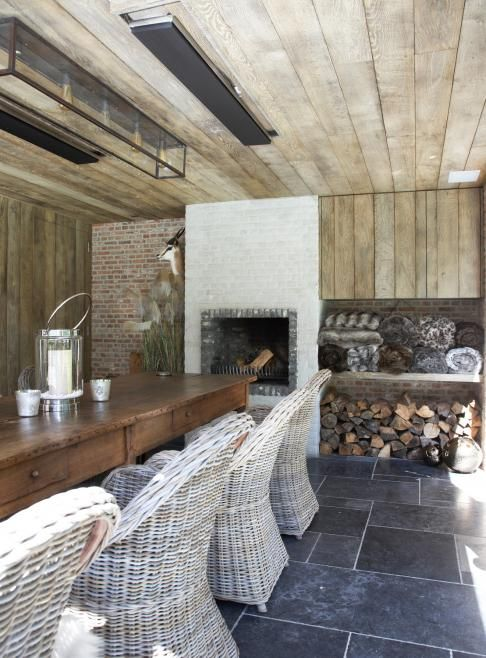 Mooie combi tegels + wit rietenstoel - could spend some time here. love the wood storage and chairs. Lekker.