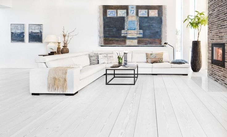 Decoration: Awesome Brick Accent Wall Mixed With White Hardwood Floor Also L Shaoed Sofa In White Plus Minimalist Metal Framed Coffee Table And Decorative Plant Also Wall Art: Attractive Wood Flooring Ideas