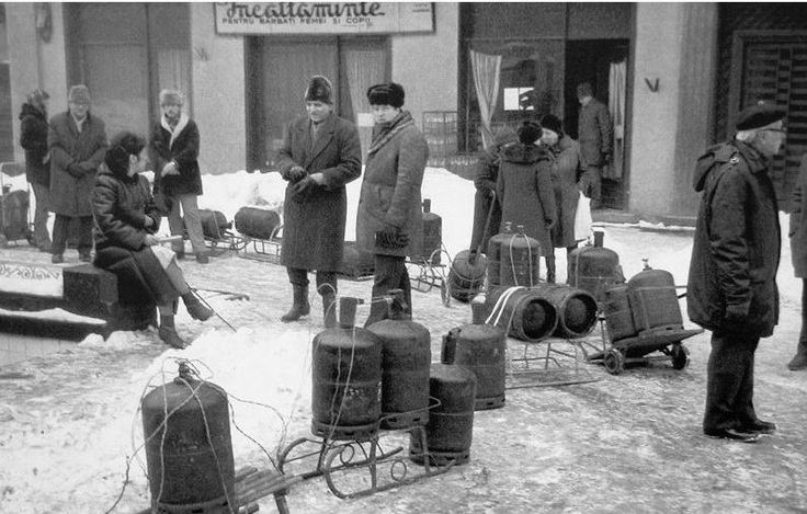 People waiting to get their  gas cylinders filled, Rosetti Street, Bucharest, Romania, 1985.