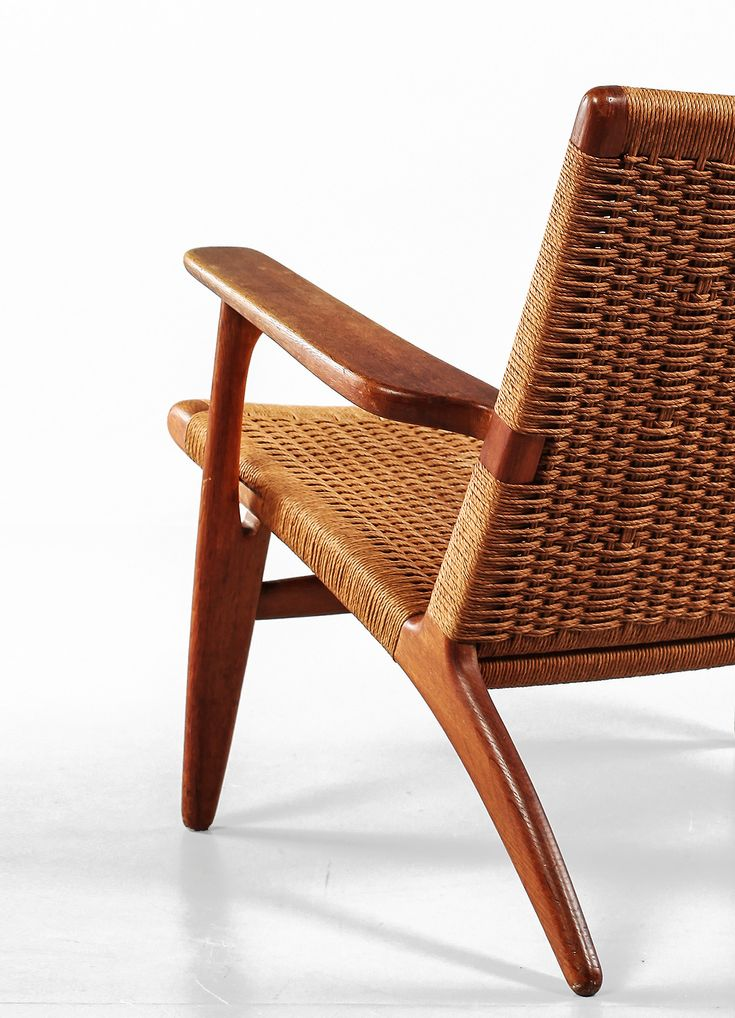 CH-25 Easy Chair by Hans Wegner, 1950. Manufactured by Carl Hansen & Søn, Denmark. Material papercord and teak. Photo copyright by Scandinavian Collectors 2014.