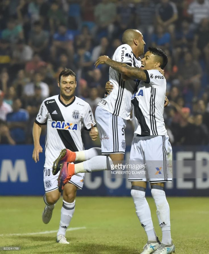 Lucca (R) of Brazil's Ponte Preta celebrates with a teammate after scoring against Paraguay's Sol de America during a 2017 Copa Sudamericana football match held at Luis Alfonso Giagni stadium, in Villa Elisa, Paraguay, on July 26, 2017. /