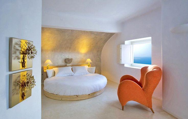 Amazing-Unique-Hotel-Bedroom-Round-Wooden-Bed-Vintage-Armchair-White-Cob-Sea-View-Honeymoon-Santorini-Greece