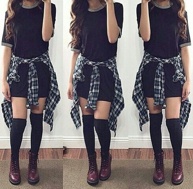 long black tshirt dress (or loose over sized black tshirt with black high waisted shorts), dark green and white plaid collared button up shirt tied around the waist, black over the knee thigh high socks, and black or dark brown lace up combat boots.