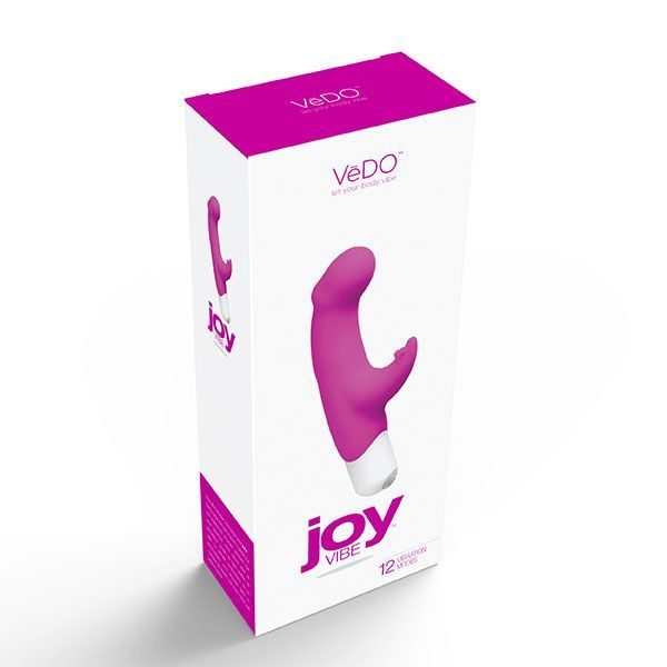 JOY pink dual action g-spot vibrator by Vedo. Joy VIBE is sure to double your pleasure. Designed to stimulate the G-spot with the gently curved head while you electrify your clitoris with the flexible rabbit tickler. This vibe is perfectly paired for a ride you'll never forget. Presented by the sex shop La Cle du Plaisir.