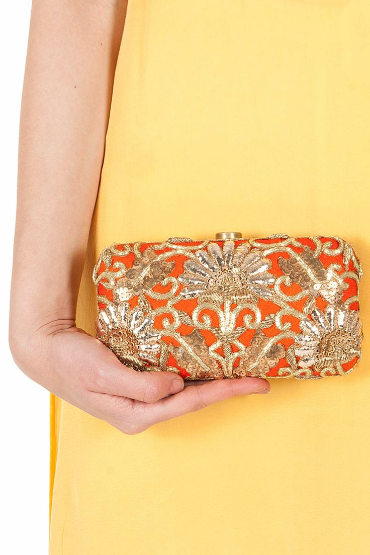 Orange prosperity clutch available only at Pernia's Pop-Up Shop.