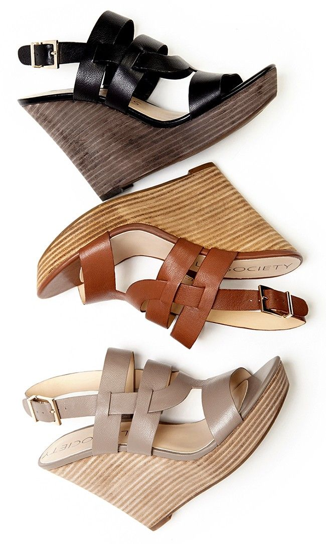 Leather wedge sandals in a walkable platform silhouette with a stacked heel and adjustable slingback closure