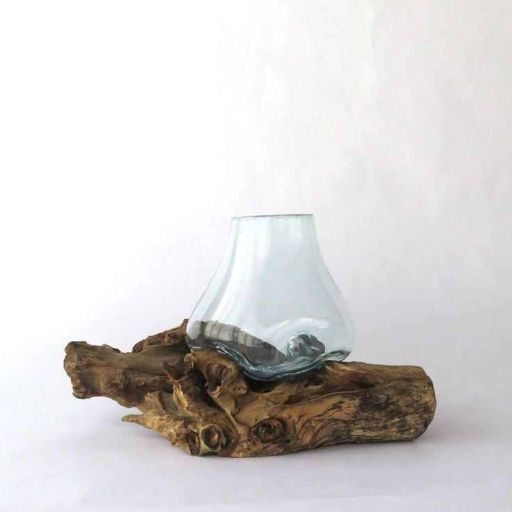 This unique terrarium would add an organic element in your home! The hand blown glass is placed directly on each piece of teak wood while it is still hot and it melds into the shape of the wood. Can b