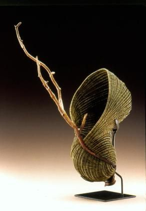 "Deborah Smith, Artist, Chrysalis, dyed reed with driftwood, Approx. Size: 8"" w  x 9 "" d  x 14"" h, (8""w x 9""d x 23""h to branch end)"