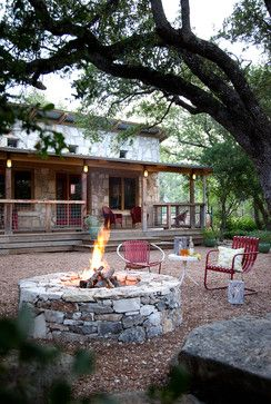 Wimberley Modern Farmhouse - by B. Jane Gardens. Who needs a back lawn to mow when you could relax around a fire pit instead?