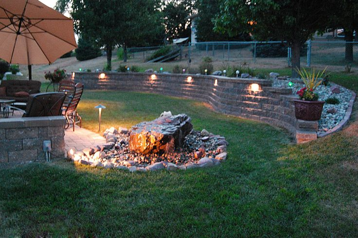 Perfect Idea!!! Retaining wall just on the other side of the creek, steps leading to the upper lawn and an open brick patio with firepit for summer nights.  MUST.HAVE.IT.