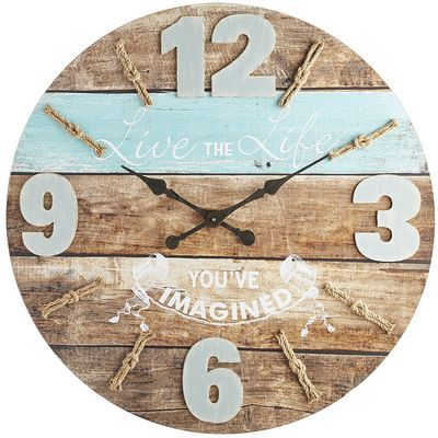 A timely reminder to live the life you've imagined. Our beautifully distressed wood clock looks like it was made from a ship of dreams. Ocean hues and rough-hewn wood with rope minute markers are looking for a place to dock. How about your place?