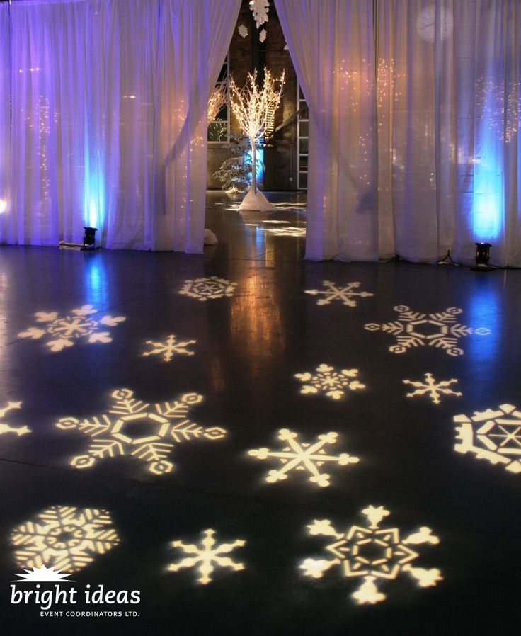 fantastic setup with snowflake gobo monogram at this uplighting wedding