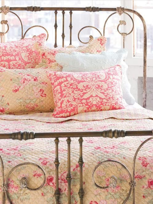 I love old iron beds and pink floral quilts. LOVE LOVE LOVE!!! If the hubby gets his game room I get my pink shabby chic bedroom:)                                                                                                                                                     More