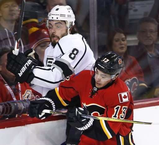 Iginla fights and scores, Kings beat Flames in chippy game  -  March 30, 2017:     Los Angeles Kings' Drew Doughty, left, is checked into the glass by Calgary Flames' Johnny Gaudreau during the first period of an NHL hockey game in Calgary, Alberta, Wednesday, March 29, 2017. (Larry MacDougal/The Canadian Press via AP)