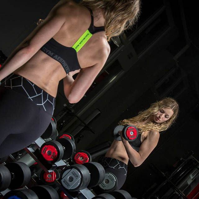 #Curls for the girls! These black Leggings and the black #bra fit perfect. #gymapparell www.gymaesthetics.com