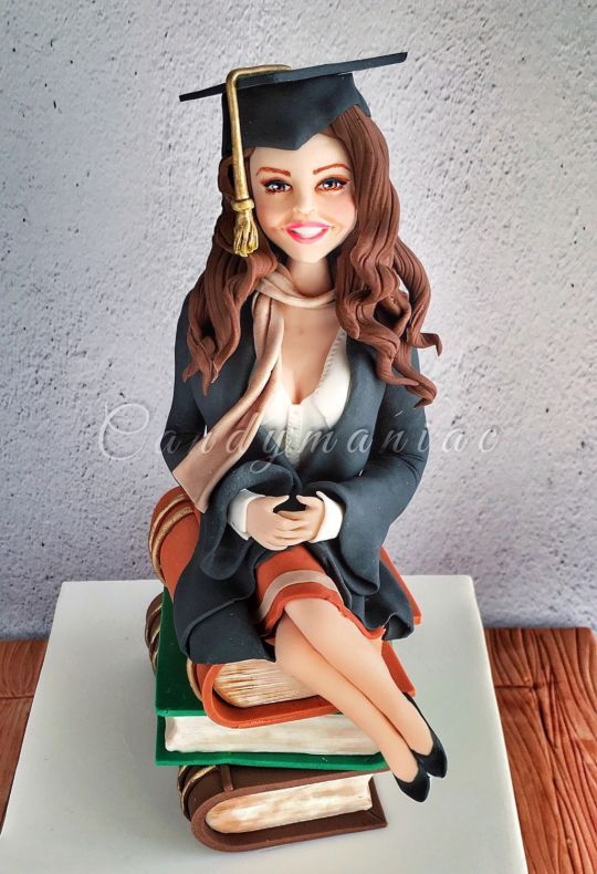 ORDERED-Cake Idea #1 - Chelsi on stack of law books wearing pink blouse - add pink purse and can we get Bo laying next to her :)