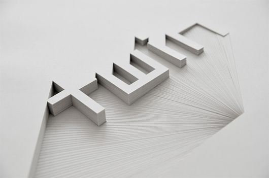 Bianca Chang cuts into paper stacks to create forms and letters with precision.
