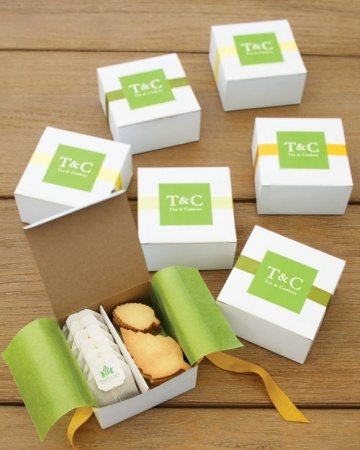 Tea and cookies were packed together in boxes lined with green glassine and sealed with a sticker bearing the couple's initials.
