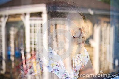 Girl In A Window With Garden Refelctions - Download From Over 61 Million High Quality Stock Photos, Images, Vectors. Sign up for FREE today. Image: 40502814