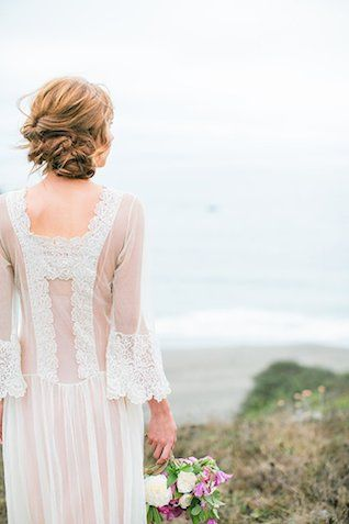 Vintage wedding dress with lace detailing on the back   Nicole Dianne Photography   see more on:  http://burnettsboards.com/2014/10/romantic-cliffside-bridal-session/