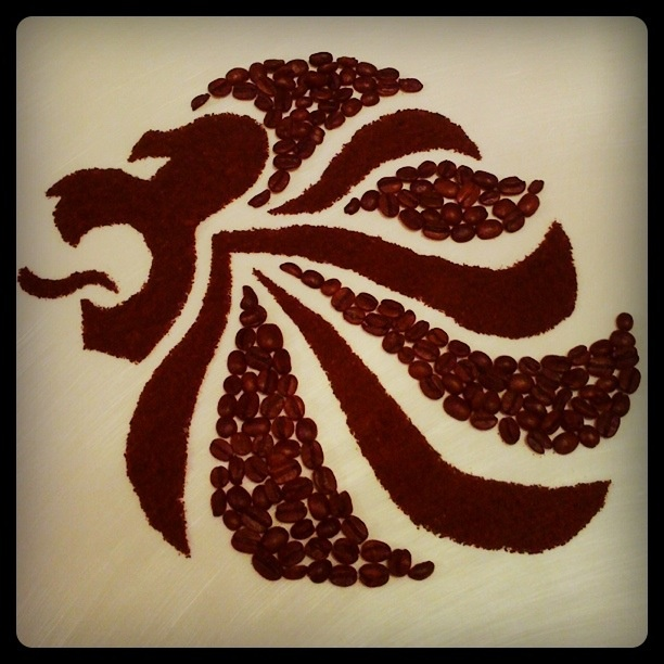 Made using coffee beans and grounds, no stencil. In honour of team GB for London 2012 Olympics. Pride the Lion