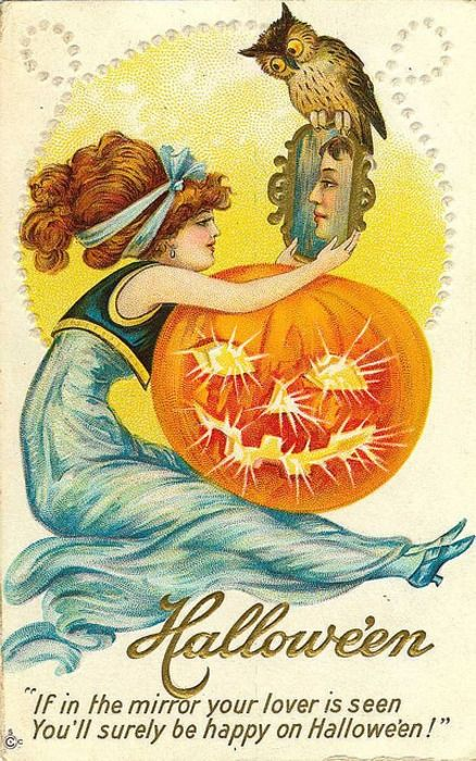 """Vintage Halloween postcard.    """"If in the mirror your lover is seen    You'll surely be happy on Halloween!"""""""