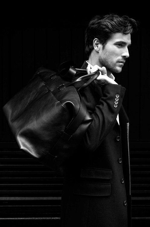 suit jacket w/dual pocket flaps + leather duffle bag.