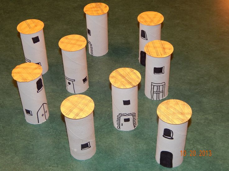 """Rahab game.  TP roll houses with """"flax"""" drying on the roof.  Hide the 2 (Peg people ) spies inside and kids take turns lifting houses to find them."""