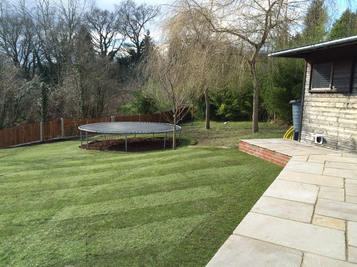 New Patio Overlooking Lawn Area And Trampoline.