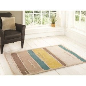 Modern rug made with hand tufted polyester. High quality rug with strips http://www.therughouse.co.uk/rugs/new-soft-yellow-teal-hand-tufted-brushstroke-polyester-rug-medina.html