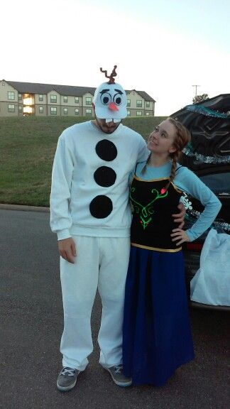 Olaf and anna adult costume, we bought skirt, shirts, sweats, and hat online, I used fabric glue for Anna's shirt, and felt for olafs buttons and hat