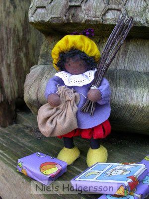 """Zwarte Piet with the """"Roe"""" and burlap bag (to take naughty children to Spain -)"""