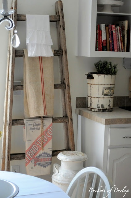 Old Wooden Ladder Holds Kitchen Towels - Notice the ice cream bucket on the counter & Milk can by the ladder!  What fun!