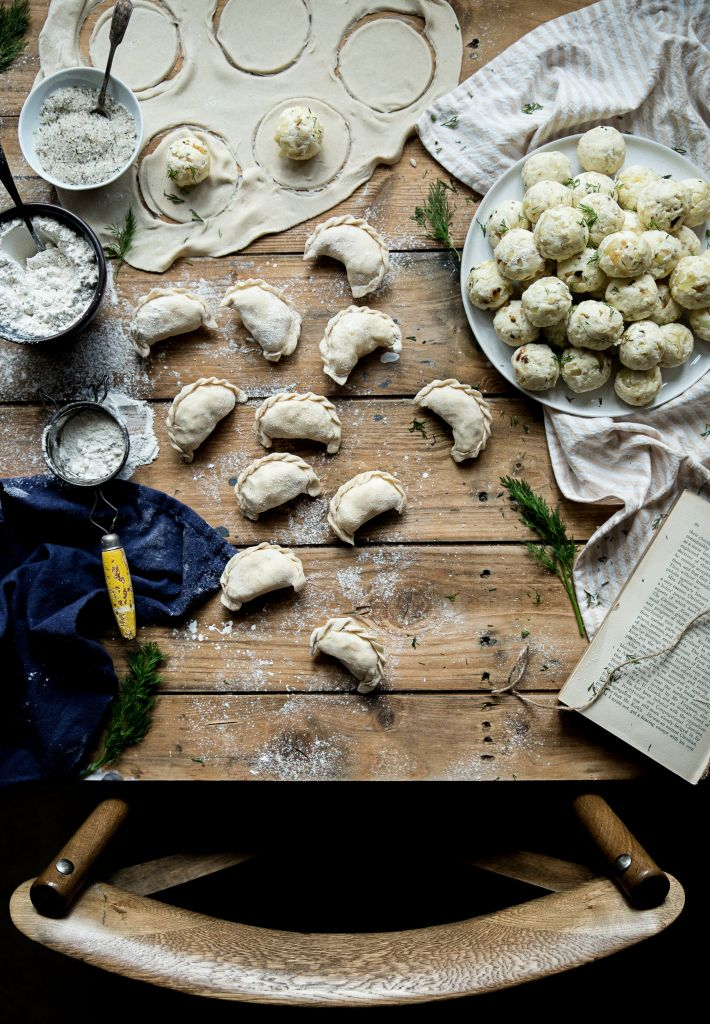 Stunning process shot! Great balance and placement of ingredient and finished pierogis #foodstyling #photography