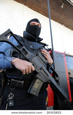 Protecting the Gateway to Mexico. CIUDAD JUAREZ, MEXICO - FEB 27: A masked and armed special forces soldier stands ready to face drug cartels on February 27, 2009, in the violence-ridden border city of Ciudad Juarez, Mexico.