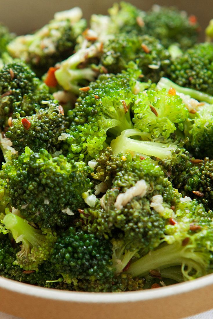 "NYT Cooking: This salad is made from uncooked broccoli tossed with an assertive garlic, sesame, chile and cumin-seed vinaigrette slicked with good extra-virgin olive oil and red wine vinegar. The acid ""cooks"" the florets a little as ceviche does fish. After an hour, the broccoli softens as if blanched, turning bright emerald, and soaking up all the intense flavors of the dressing. You'll be making this one again."