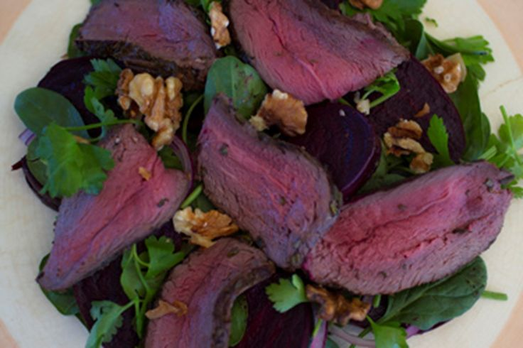 Venison is tasty and really lean and a great source of iron. It is a rich meat and it is so yummy when roasted with lots of rosemary and garlic. We love having this gorgeous meat with balsamic roasted beetroot — beetroot is really good for you with many nutritional benefits and has a delicious earthy flavour. Add a few dark green spinach leaves and the roasting juices from the beetroot to dress and you are in business.