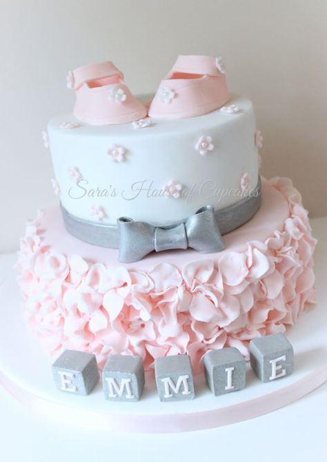 love the pretty pink petals on this baby shower cake