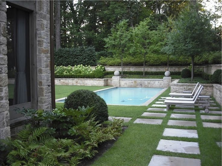 Yet another lovely pool surrounded by grass. Love it.