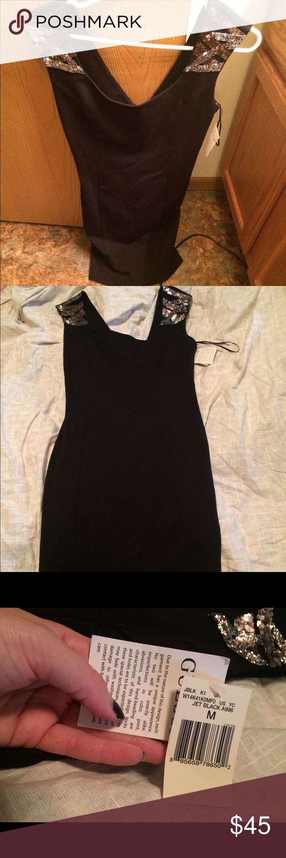 Black Guess dress NWT Brand new. Body forming dress - size medium. Sequined patches on shoulder! Beautiful. Guess Dresses Mini